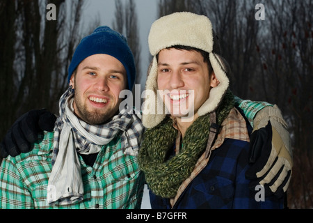 Two friends outside in winter hanging out - Stock Photo