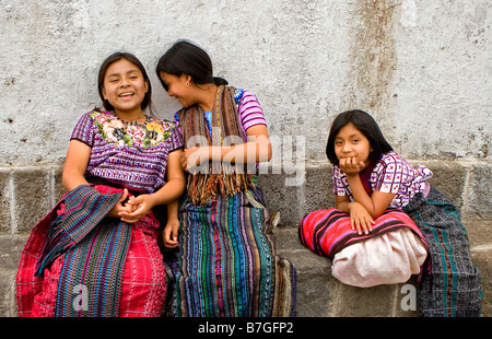 Guatemalan children in traditional dress relax outside a church in Santiago Atitlan, Guatemala - Stock Photo