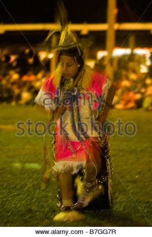 Teenage Indian boy, blurred motion, Mens Traditional Dance, Crow Fair powwow, Crow Indian Reservation, Montana - Stock Photo