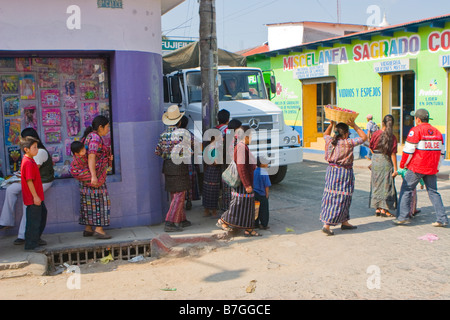 Solola Maya in traditional dress walk through the streets during a busy market day Solola, Guatemala - Stock Photo