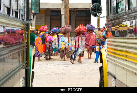 A funeral procession through two chicken buses, Zunil, Western Highlands, Guatemala - Stock Photo