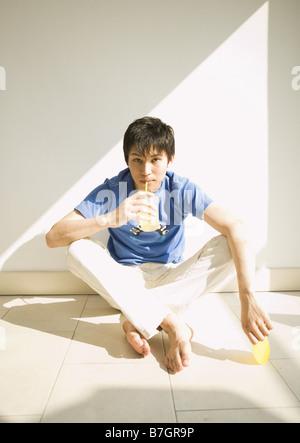 Man drinking juice - Stock Photo