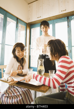 Women reluxing at cafe - Stock Photo