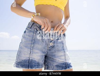 Woman wearing shorts - Stock Photo