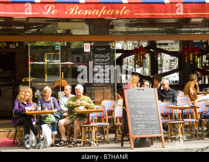 People enjoying food and drink at Le Bonaparte, at Place Saint Germain des Pres in Paris, France Europe - Stock Photo
