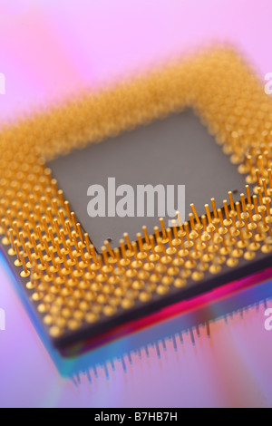 Computer cpu processor chip on purple background - Stock Photo