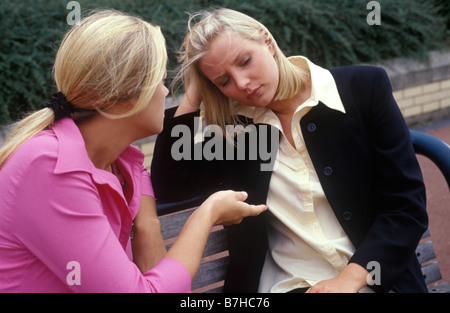 two young women talking seriously - Stock Photo