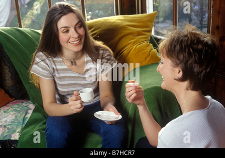 2 women chatting over a cup of coffee - Stock Photo