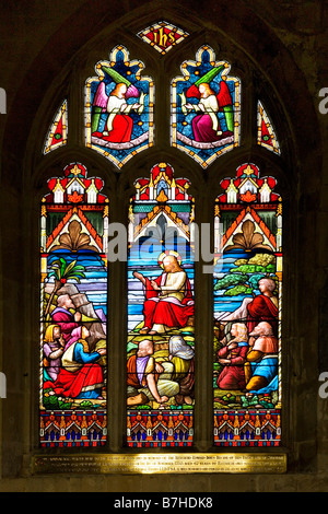Stained glass window in St John's Church in the typical English market town of Devizes Wiltshire England UK - Stock Photo