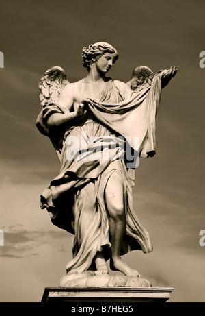 Angel Statue along Pont Sant Angelo, Rome Italy - Stock Photo