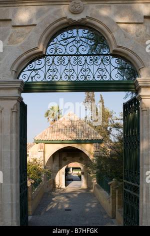 View through Hala Sultan Tekkesi mosque entrance gate near Larnaca, Cyprus - Stock Photo