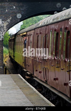 A steam train leaves Weybourne station on the Poppy Line in Norfolk, England. UK - Stock Photo