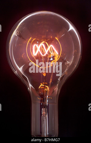 A clear 1000 watt OSRAM Incandescent lightbulb manufactured in the 1930s and still working. - Stock Photo