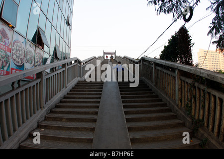 Child Running Up stairs Playing on stairs in China - Stock Photo