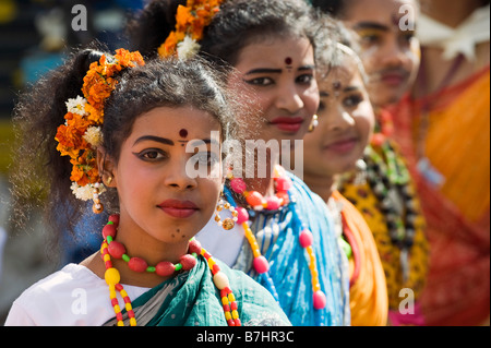 Three Hindu Indian Children dressed as Gopi's for a street pageant in the town of Puttaparthi, Andhra Pradesh, India - Stock Photo