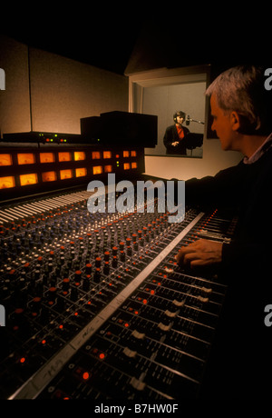 Sound Engineer and talent in sound recording studio. Vancouver, BC, Canada - Stock Photo