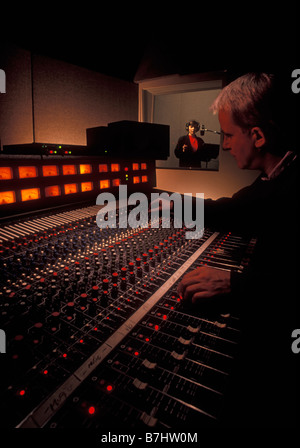 Sound Engineer and talent in sound recording studio. Vancouver, BC, Canada. - Stock Photo