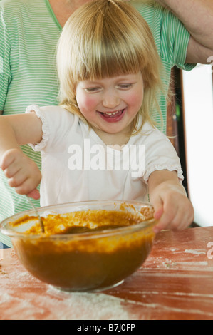 Young Girl Helping to Make a Pumpkin Pie, Vancouver, B.C. - Stock Photo