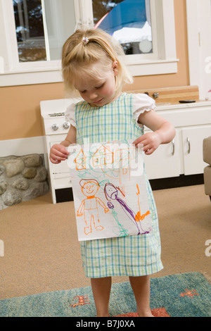 3 year old girl showing her artwork, B.C. - Stock Photo