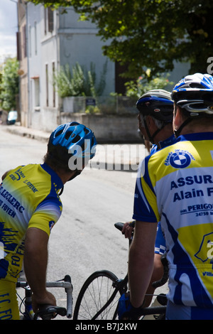 Cyclists await fellow competitors before a cycle race in Villefranche de Lonchat, France. - Stock Photo