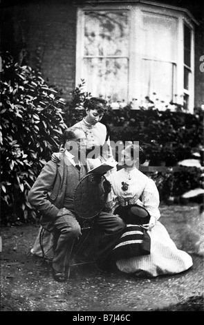 Charles Dickens Reading To His Daughters Mamey and Katey in the garden of his house at Gads Hill Kent in 1866 - Stock Photo