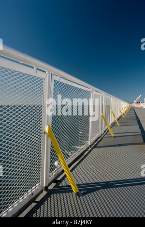 White railing and blue sky of a ferry boat, BC Ferries, Nanaimo, BC, Canada - Stock Photo