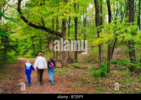 Family hikes through Balls Falls Conservation Area. - Stock Photo