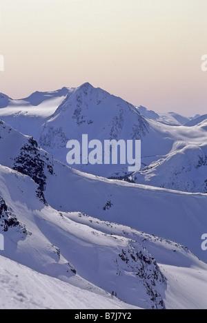 Fissile Mountain rises from Blackcomb Mountain ski area, Whistler, BC Canada - Stock Photo