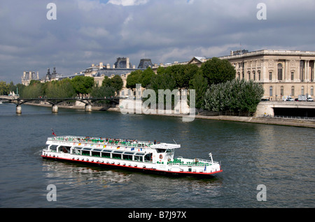 Sightseeing on the river Seine in Paris - Stock Photo