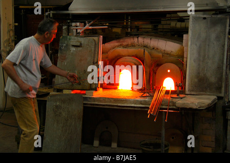 Glass blowers at work on the island of Murano - Stock Photo