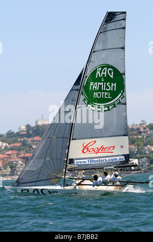18ft Skiff racing in Sydney harbour australia boat rag and hamish hotel - Stock Photo