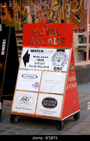 Advertising board outside the Royal Arcade shopping area, linking Old Bond Street to Albermarle Street, Westminster, - Stock Photo