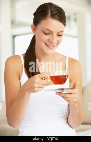 Young Woman Drinking Herbal Tea - Stock Photo