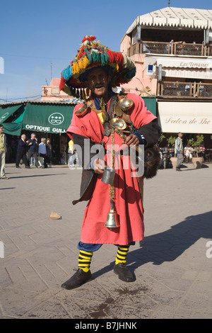 Marrakech Morocco North Africa December One of the colourfully dressed water carriers in Jemaa el Fna - Stock Photo