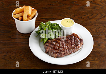 sirloin steak chunky chips watercress bearnaise sauce - Stock Photo