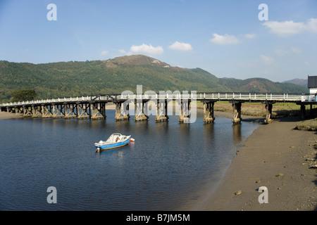 Penmaenpool wooden bridge over the River Mawddach near Dolgellau, Gwynedd, North Wales - Stock Photo