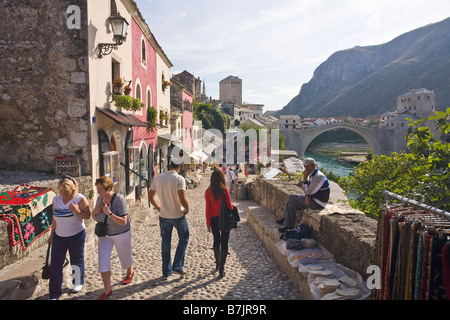Historic Old Town of Mostar and restored 16th century bridge across the Neretva River in Bosnia Herzegovina Europe - Stock Photo