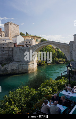 Historic Old Town of Mostar and restored 16th century bridge across the Neretva River in Bosnia Herzegovina Europe - Stock Photo