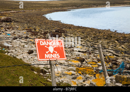 A sign warning of danger of a minefield on The Falkland Islands - Stock Photo