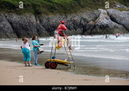 Lifeguard on duty at Caswell Bay in the Gower Wales - Stock Photo