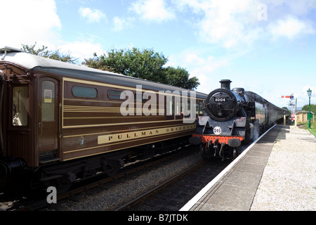 Two steam trains pull into Harmans Cross Station on the Swanage Railway in Dorset - Stock Photo