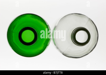 Abstract looking down on top of empty green and clear glass bottles - Stock Photo