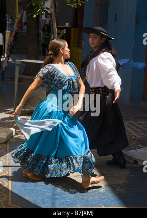 Tango dancers in street cafe in La Boca Buenos Aires Argentina South America - Stock Photo