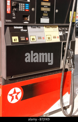 Closeup of gas station pump showing octane ratings of unleaded regular and premium gasoline - Stock Photo