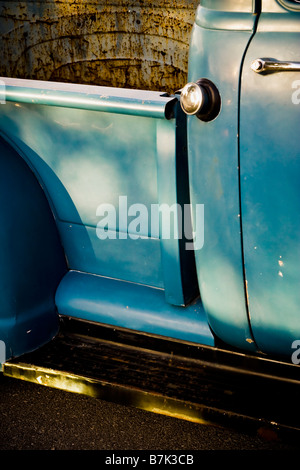 Detail of a vintage pickup truck sitting in the warm evening sunlight. - Stock Photo