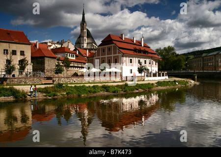St. Vitus Church and Building Reflections in the Vltava River in Cesky Krumlov, Bohemian village in the Czech Republic - Stock Photo