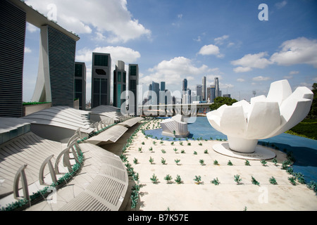 A scale model of the Marina Bay Sands casino resort is seen with the financial district in the background, in Singapore - Stock Photo