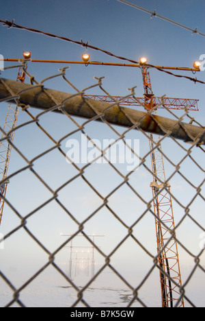 Airport approach towers and chain link fence, Victoria International Airport near Sidney, BC, Canada - Stock Photo