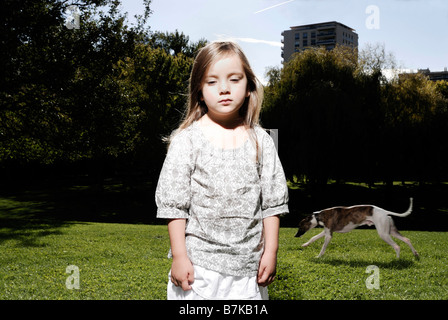 5 years old girl looking at camera - Stock Photo