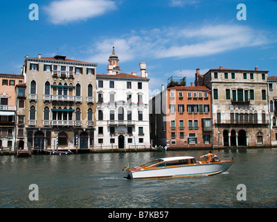 Grand Canal, Venice, Italy (red building featured in James Bond film Casino Royale) - Stock Photo